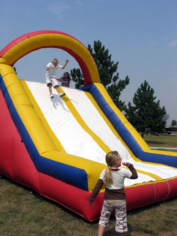 Children seemed unable to resist the temptation of an inflatable slide that combined the bounce of a jumpy castle and the speed of the slope during the Ellsworth base picnic Aug. 20. This annual family-friendly event was sponsored primarily by local businesses as a way to say thank you to active-duty Airmen, retirees, Department of Defense civilians and families for their hard work, dedication and sacrifices. The picnic featured free food, athletic competitions, tournaments and children-specific activities from arts and crafts to jumping castles. (U.S. Air Force photo/Staff Sgt. Shanda De Anda)