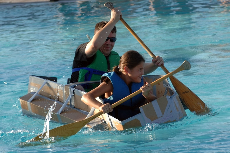 DYESS AIR FORCE BASE, Texas -- The Airman & Family Readiness Center Ducks show off their sailing skills at the base pool during Build-a-Boat Aug. 21. The Ducks' idea to use pontoons paid off when they kept their boat afloat. (U.S. Air Force Photo by Airman First Class Micheal S. Breaux)