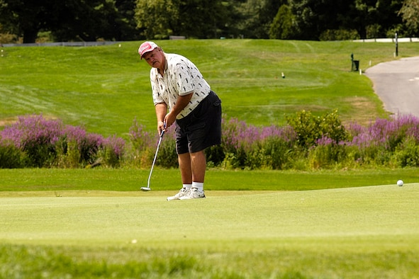 Hanscom Air Force Base, Mass. -- Paul Peters putts the ball during the recent Patriot Golf Course Championship Tournament. (U.S. Air Force photo by Walter Santos)