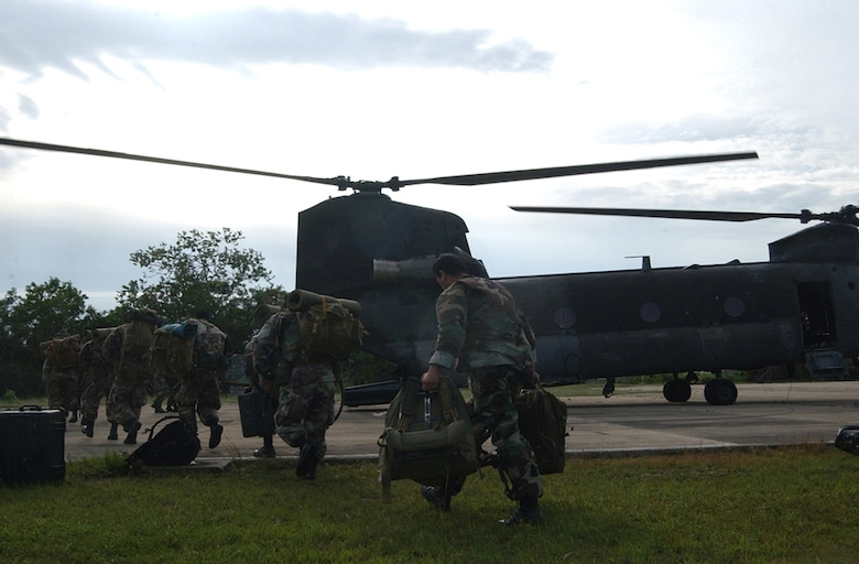 BELIZE CITY, Belize ? Members of the Belizean Defense Force here board a U.S. Army CH-47 Chinook helicopter to be transported to other areas within the country following the landfall of Hurricane Dean here Aug. 21.  The Chinook, assigned to the 1st Battalion, 228th Aviation Regiment at Soto Cano Air Base, Honduras, transported approximately 20 U.S. Soldiers and Airmen here as part of an initial assessment team following the hurricane.  (U.S. Air Force photo by Tech. Sgt. Sonny Cohrs)
