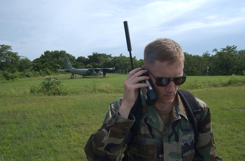 BELIZE CITY, Belize - Air Force Maj. Jason Clark, operations officer for the Tactical Operations Center here, uses a satellite phone to contact Joint Task Force-Bravo headquarters at Soto Cano Air Base, Honduras, shortly after touching down here.  Approximately 20 Soldiers and Airman from Soto Cano Air Base, Honduras, deployed here as part of an initial assessment team following Hurricane Dean Aug 21.   (U.S. Air Force photo by Tech. Sgt. Sonny Cohrs)