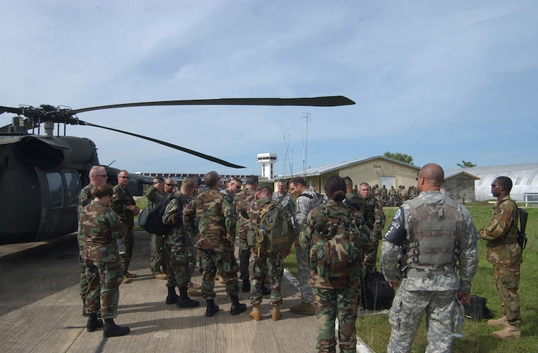 BELIZE CITY, Belize - Approximately 20 Soldiers and Airmen from Soto Cano Air Base, Honduras, deployed here as part of an initial assessment team following Hurricane Dean Aug 21. The team members were transported via two UH-60 Black Hawk and one CH-47 Chinook helicopter. The team is comprised of a security detail, medics, engineers, search and rescue assets and communications specialists.    (U.S. Air Force photo by Tech. Sgt. Sonny Cohrs)