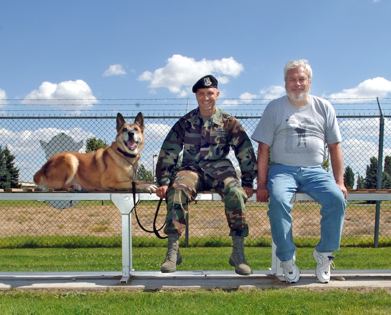 FAIRCHILD AIR FORCE BASE, Wash. -- After a day of touring the military working dog facilities here and putting Tico, a military working dog, through some paces on the obstacle course, Tech. Sgt. Max Talley, 92nd Security Forces Squadron kennel staff, Mr. David Adams and Tico take a break on the dog walk. Mr. Adams, a former dog handler with the 92nd Bomb Wing, was visiting Fairchild nearly 30 after he was stationed here. (U.S. Air Force photo / Airman 1st Class Josh Chapman)