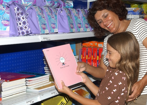 "While shopping for school supplies at the Lackland Air Force Base main base exchange Aug. 20, Sarah Berry, 8, and her mother, retired Senior Master Sgt. Reda Berry, get a laugh from the ""Boys are Smelly"" notebook. The Lackland ISD schools open their doors for the 2007-08 school year Aug. 27. (USAF photo by Alan Boedeker)"
