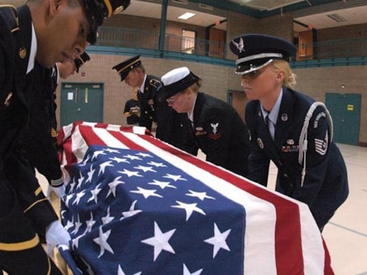 From right to left, Technical Sgt. Jolene R. Savageau, 119th Wing; Petty Officer 2nd Class Mary Sims; SPC Kacey Kruger; Staff Sgt. Travis Hackey; SPC Jorge Elizondo place a training casket during military funeral honor team training at the Armed Forces Reserve Center, Fargo, N.D., August 17, 2007.  (USAF photo/SMSgt. David Lipp)