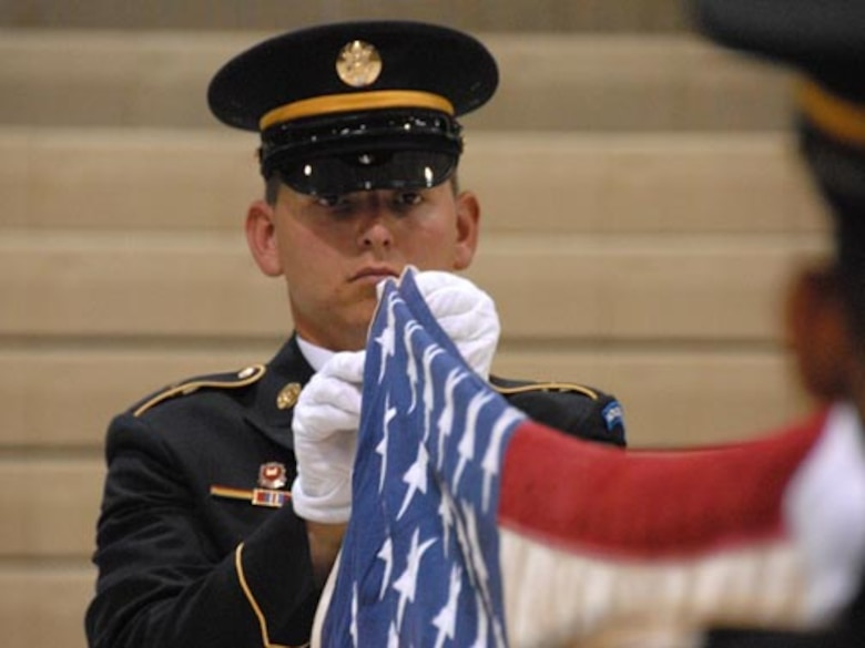 SPC David Saari, North Dakota Army National Guard, folds the United States flag during military funeral honors team training at the Armed Forces Reserve Center, Fargo, N.D., August 17, 2007.  (USAF photo/SMSgt. David Lipp)