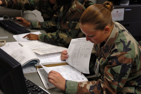Airman 1st Class Christina Johnson, 18th Aerospace Medicine Squadron, reviews medical records of those preparing to deploy during Kadena's Local Operational Readiness Exercise.