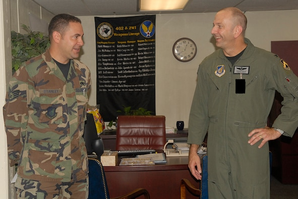 "KUNSAN AIR BASE, South Korea -- Colonel Creig ""Wolf 2"" Rice, 8th Fighter Wing vice commander, talks with Staff Sgt. Jack Stanley, 8th Maintenance Group weapons loade,r here Aug. 16. Sergeant Stanley was recognized as the 8th FW's Pride of the Pack for the week of Aug. 13. (U.S. Air Force photo/Senior Airman Giang Nguyen)"