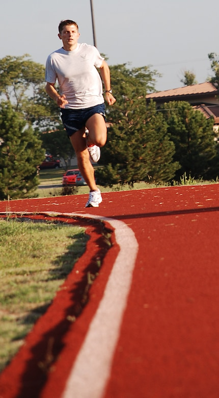 Second Lt. Anthony D'Amato, 22nd Communications, Squadron sprints down the base track Aug 23. He is training to compete at the 11th annual Air Force Marathon at Wright Patterson Air Force Base, Ohio, Sept. 15. (photo by Airman 1st Class Jessica Lockoski)