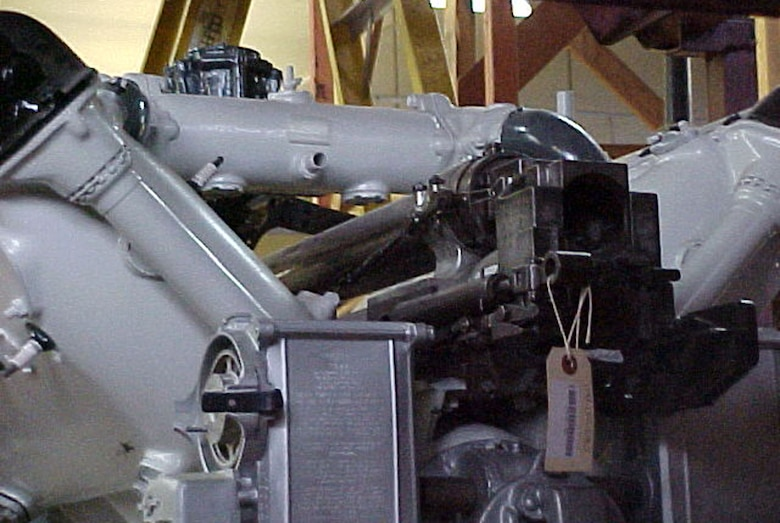 The first successful aircraft cannon -- a 37mm M3 cannon -- was mounted in the vee of the Hispano-Suiza V type, 8-cylinder, liquid-cooled engine for firing through the hollow propeller shaft. The French Hispano-Suiza engine was built in 1918 in the United States by the Wright-Martin Co. (U.S. Air Force photo)