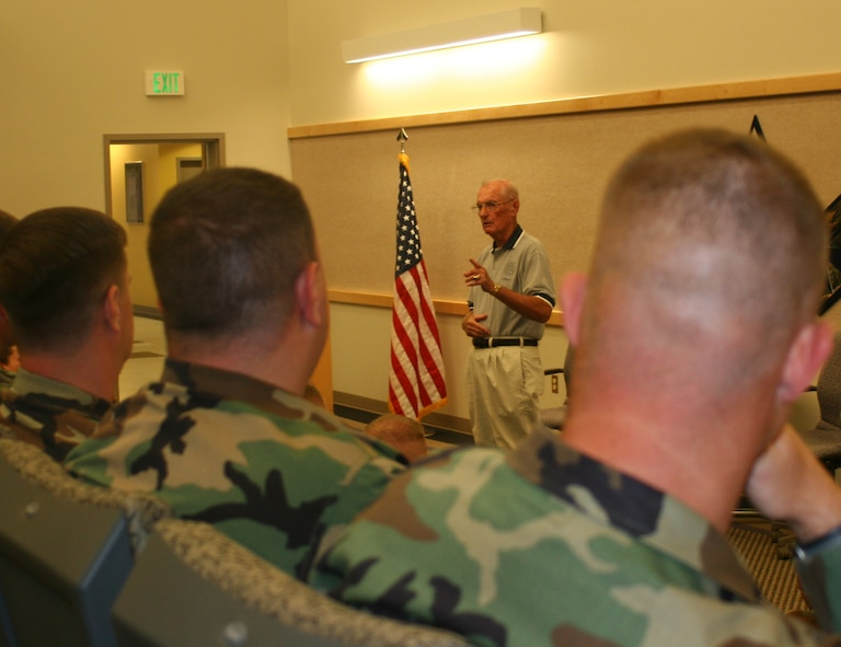 Retired Chief Master Sergeant of the Air Force James McCoy, speaks to Team Whiteman's newly selected senior NCOs at the professional development center prior to the SNCO induction ceremony Aug. 24. Chief McCoy, who was guest speaker of the ceremony, entered the Air Force in 1951 and served with the Air Defense Command as a radar operator and instuctor. He was selected as one of the 12 Outstanding Airmen of the Air Force in 1974, and became the sixth chief master sergeant of the Air Force in Aug. 1979. (U.S. Air Force photo/Staff Sgt. Rob Hazelett)