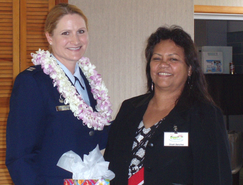 A Federal Women's Program Equality Day Luncheon in celebration of the 85th Anniversary of Women's Equality Day.  Guest speaker, Captain Tamara Duke-Patrick (left) and FWP President, Dinah Sanchez (right)