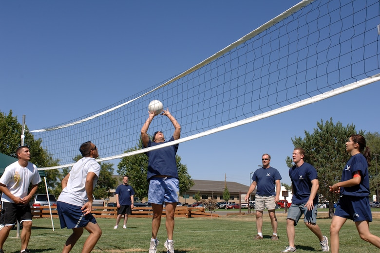 Members of the 75th Air Base Wing Public Affairs office square off against members from the 649th Munitions Squadron in volleyball during the Air Force 60th Birthday Bash Sports Day. Other competitive activities were included such as horse shoes, tug o' war, table tennis, arm wrestling and disc golf.