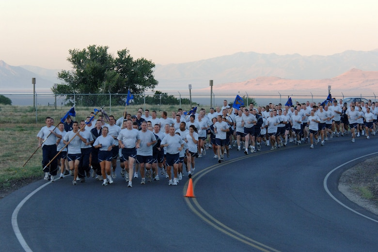 Squadrons from the 75th Air Base Wing participated in a formation run early Aug. 24 for the kick off of sports day. The run was led by Col. Linda Medler, 75th Air Base Wing vice commander, and Chief Master Sgt. William Gurney, Ogden Air Logistics Center and 75th Air Base Wing command chief. (U.S. Air Force Photo by Alex R. Lloyd)