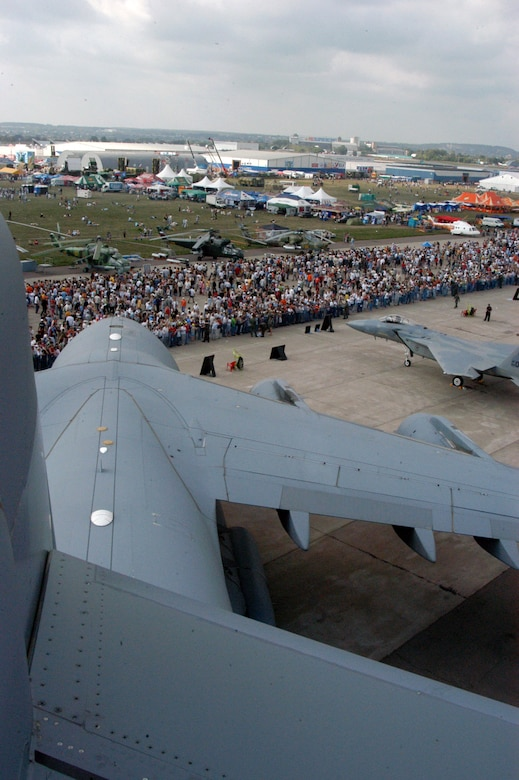 A view from the tail of the C-17 Globemaster III shows just some of the thousands of people who visited the Moscow International Air Show Aug. 26 in Zhukovsky, Russia. A KC-135 Stratotanker from Royal Air Force Mildenhall, England; an F-15 Eagle from RAF Lakenheath, England; a B-52 from Barksdale Air Force Base, La.; a C-17 Globemaster II from McChord AFB, Wash., and two F-16 Fighting Falcons from Spangdahlem Air Base, Germany, were on static display at the air show, along with many other aircraft from all over the world. The air show began Aug. 21 and concluded Aug. 26, and had more than 500,000 visitors. (U.S. Air Force photo/Maj. Pamela A.Q. Cook)