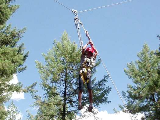 FAIRCHILD AIR FORCE BASE, Wash. – MaKenzie Oldenburg zips down the high-rope obstacle at the Adventure Dynamics ropes course near Spokane, Wash. MaKenzie, a student at Michael Anderson Elementary School here, attended the Drug Abuse Resistance Education program camp Aug. 20-24. The camp was open to students who finished a 10-week DARE classroom program, an international program that gives children skills to avoid drug, gang and violence involvement. (U.S. Air Force photo / Susan Conard)
