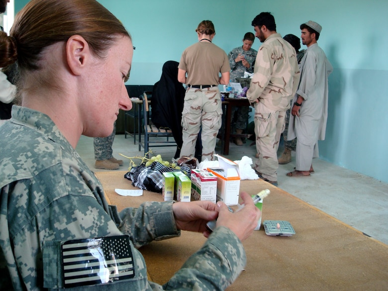 Staff Sgt. Jill Renshaw prepares de-worming medication for Afghan patients during a Village Medical Outreach Aug. 22 in the Shinkay District, Afghanistan. Nearly 200 people were seen by Provincial Reconstruction Team Qalat medics. (U.S. Air Force photo/Capt. Bob Everdeen)