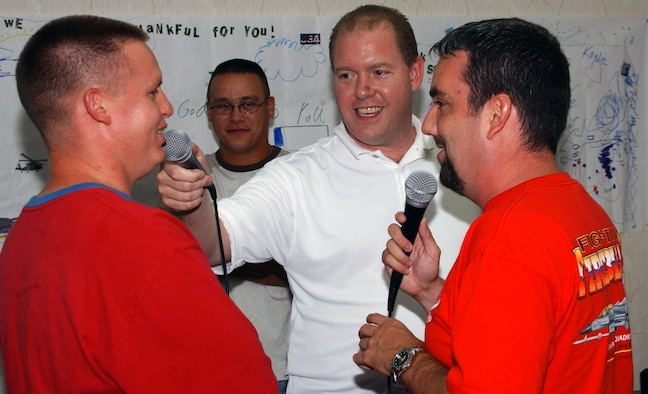 ANDERSEN AIR FORCE BASE, Guam - Steve Rooney, center, and Duffy Moon, right, interview Staff Sgt. Michael J. Vaughn, 36th Expeditionary Aircraft Maintenance Squadron, while he sends an audio greeting to his family at Cannon Air Force Base N.M. Mr. Rooney and Mr. Moon are radio personalities from Clovis, N.M., who visited the Airmen from Cannon who are deployed to Andersen AFB.  During their visit, the two DJs shared the pride the families, Cannon AFB, and the Clovis community have expressed for the expeditionary warriors who are deployed here.