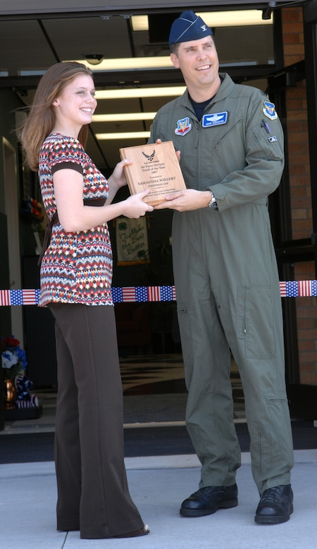 WHITEMAN AIR FORCE BASE, Mo. – Col. John Robinson, 509th Bomb Wing vice commander gives the 2007 Air Force Services Youth of the Year Award to Samantha Wielert at the youth center ribbon cutting ceremony Aug. 24. The youth center programs include before and after school care, youth sports and fitness and youth development and recreation programs for youth ages 5-18 years of age. (U.S. Air Force photo/Airman 1st Class Stephen Linch)