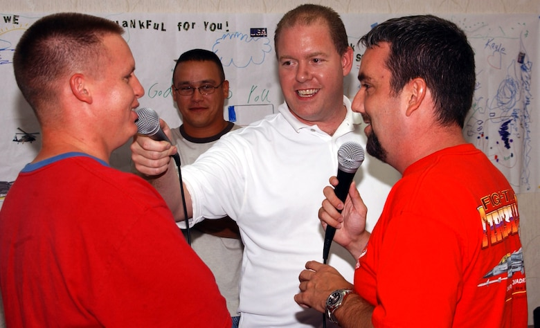 Steve Rooney (center) and Duffy Moon (right) interview Staff Sgt. Michael Vaughn while he sends an audio greeting to his family Aug. 27 at Andersen Air Force Base, Guam. Mr. Rooney and Mr. Moon are radio personalities from Clovis, N.M., who visited Airmen deployed to Andersen AFB from Cannon AFB, N.M. Sergeant Vaughn is assigned to the 36th Expeditionary Aircraft Maintenance Squadron in Guam deployed from Cannon AFB. (U.S. Air Force photo/Master Sgt. Art Webb)