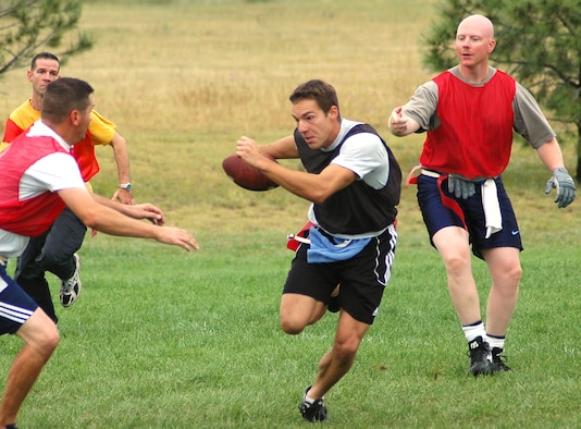 SCHRIEVER AIR FORCE BASE, Colo. -- 50th OSS/OG quarterback Craig Cherek runs through the defense during intramural flag football action Aug. 30. Cherek threw two touchdown passes to aid in his team's victory over NOPS. (U.S. Air Force photo/Lorna Gutierrez)