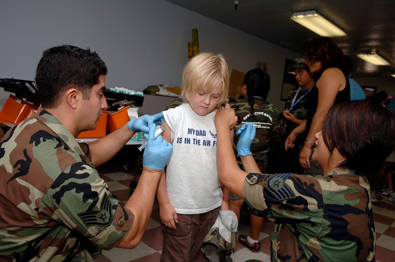 Amilia Dumas, 4, gets her shots during the deployment line. (Photo by Paul Testerman)