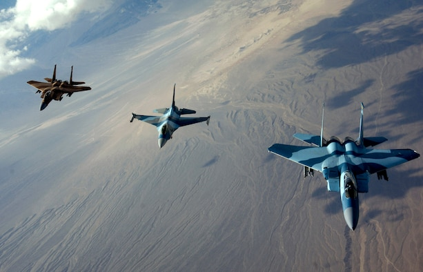 The 64th Aggressor Squadron's F-15 Eagles and F-16 Fighting Falcon head to the fight after refueling Aug. 28 during Red Flag 07-3 exercise at Nellis Air Force Base, Nev. Red Flag tests aircrew war-fighting skills in realistic combat situations. The aircraft fly missions during the day and night to the nearby Nevada Test and Training Range to simulate an air war. Servicemembers from all the U.S. military branches, along with coalition forces, are participating in the event. (U.S. Air Force photo/Master Sgt. Kevin J. Gruenwald)