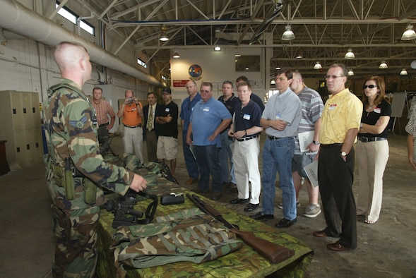 94th Security Forces Squadrion member, Senior Airman Alan Perry briefs a group of employers during Dobbins' annual Employers Day visit. The day is a joint effort with Employer Support of the Guard and Reserve meant to educate bosses on the things their reserve employees accomplish during drill weekends. (Air Force photo/Don Peek)