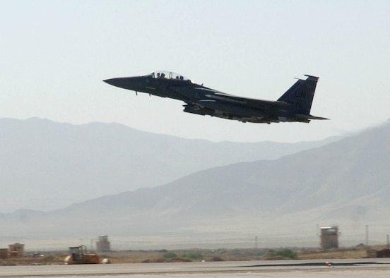 BAGRAM AIRFIELD, Afghanistan -- An F-15E Strike Eagle, assigned to the 492nd Expeditionary Fighter Squadron, takes off from Bagram Airfield, Afghanistan. The 492nd EFS is deployed from RAF Lakenheath, England. The F-15E's primary role in Afghanistan is providing close-air support for ground troops. (U.S. Air Force photo by Staff Sgt. Craig Seals)