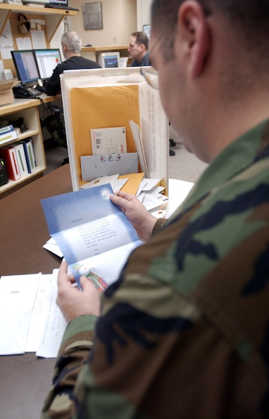 EIELSON AIR FORCE BASE, Alaska -  Staff Sgt. Matthew Bohlman, 354th Operations Support Squadron weather technician, reads a letter from Hayes Kohler, a girl who lives in Europe, while coordinating the Santa's Mailbag program here at Eielson AFB, Alaska, Nov. 26, 2007. The 354th Operations Support Squadron's Santa's Mailbag program reads and responds to letters written from children all over the world. This program has been active for 53 years and is a holiday tradition for the men and women of the 354th Operation Support Squadron. (U.S Air Force photo by Staff Sgt Eric T. Sheler)