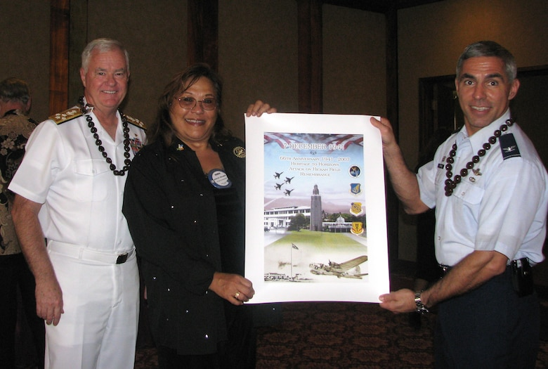 Col Torres (right) presented a Dec 7th Commemorative Poster to Dona McLaughlin, President of Rotary Club of Pearl Harbor, at Heroes  luncheon; (left) Admiral Keating, Commander of the U.S. Pacific Command.