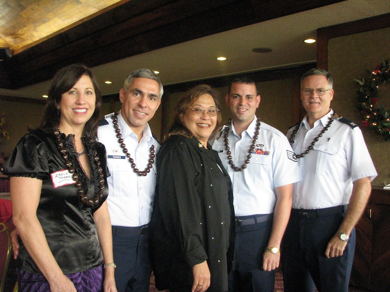 Posed with Hickam Heroes, Capt Parrish, 15th Airlift Wing Chapel Center (right), SSgt Torres, 15th Maintenance Operations Center Controller, Mrs. Dona McLaughlin, President of Rotary Club of Pearl Harbor, Colonel Torres, 15th Airlift Wing Commander and his wife Irene Torres.