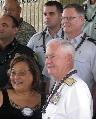 Posed by group of heroes (bottom left) Dona McLaughlin, President of Rotary Club of Pearl Harbor, Admiral Keating, Commander of the U.S. Pacific Command,  Capt Parrish, 15th Airlift Wing Chapel Center (right above from Adm Keating), and SSgt Torres, 15th Maintenance Operations Center Controller (left).