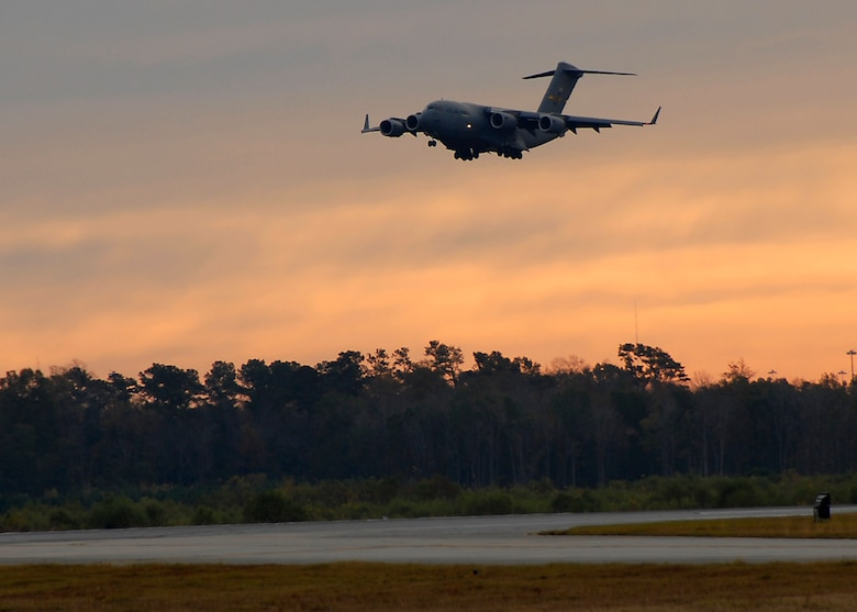 The 315th Airlift Wing aircrew that broke the 100,000 flight hour mark in support of the Global War on Terror lands their C-17 in the early morning hours at Charleston Air Force Base, S.C. (photo by Capt. Chett Collier)