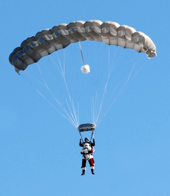 Santa skydives onto the 37th Training Wing parade field at Lackland Air Force Base, Texas, on Dec. 4 to help TxDOT kick off their annual four-week drunken driving prevention campaign. This is the 10th year of the Texas Department of Transportation's holiday public education campaign.  (USAF photo by Alan Boedeker)