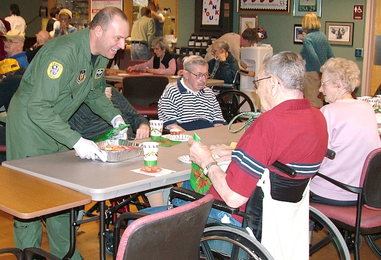Master Sgt. Christopher Maille, serves veterans at the Soldiers Home in Holyoke, Mass., Nov. 29. Sergeant Maille was among more than 80 members of the 439th Airlift Wing who visited the Soldiers Home as part of serving food and dropping off donated items.