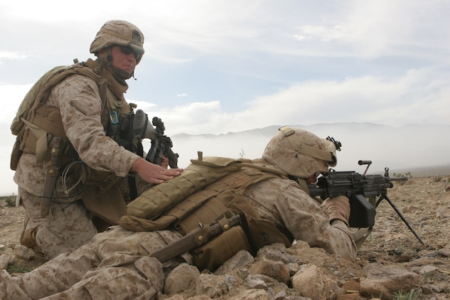 Cpl. Kyle Blades, team leader, 1st squad, 2nd platoon, Fox Company, 2/24, guides the fire of Lance Cpl. Matt Shimon, SAW gunner, 2nd platoon, Fox Company, 2/24.