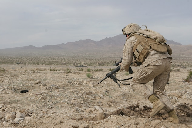 Lance Cpl. Andrew Morgan, designated marksman, 1st squad, 2nd platoon, Fox Company, 2/24, fires precision shots at an enemy bunker.