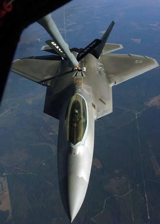F-22 Raptor pilots from the 43rd Fighter Squadron, Tyndall AFB, Fla. conduct an air-to-air refueling training mission over Eglin AFB Dec. 4. The 916th Air Refueling Wing, which is an Air Force Reserve Wing located at Seymour Johnson AFB, N.C., provided KC-135R Stratotanker support during the mission. Tanker and fighter units from across the country travel to the Florida Panhandle to support the Raptor training mission based at Tyndall AFB. (U.S. Air Force photo/Staff Sgt. Bryan Franks)