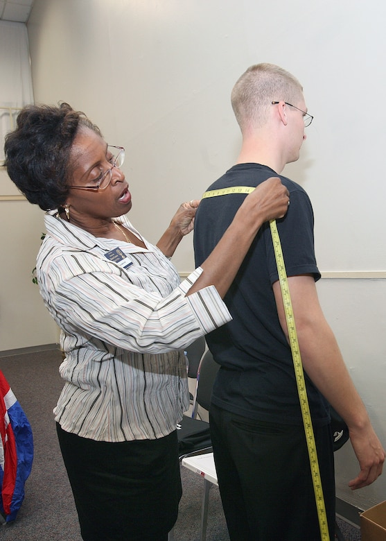Gloria Singleton, 37th Mission Support Group, takes the measurements of Airman 1st Class Jaron Seleis on Monday at the Arnold Hall Community Center. Airmen from around the world are participating in the Worldwide Talent Contest this week on Lackland Air Force Base, Texas, where they will vie for positions on the 2008 Tops In Blue team. (USAF photo by Robbin Cresswell)