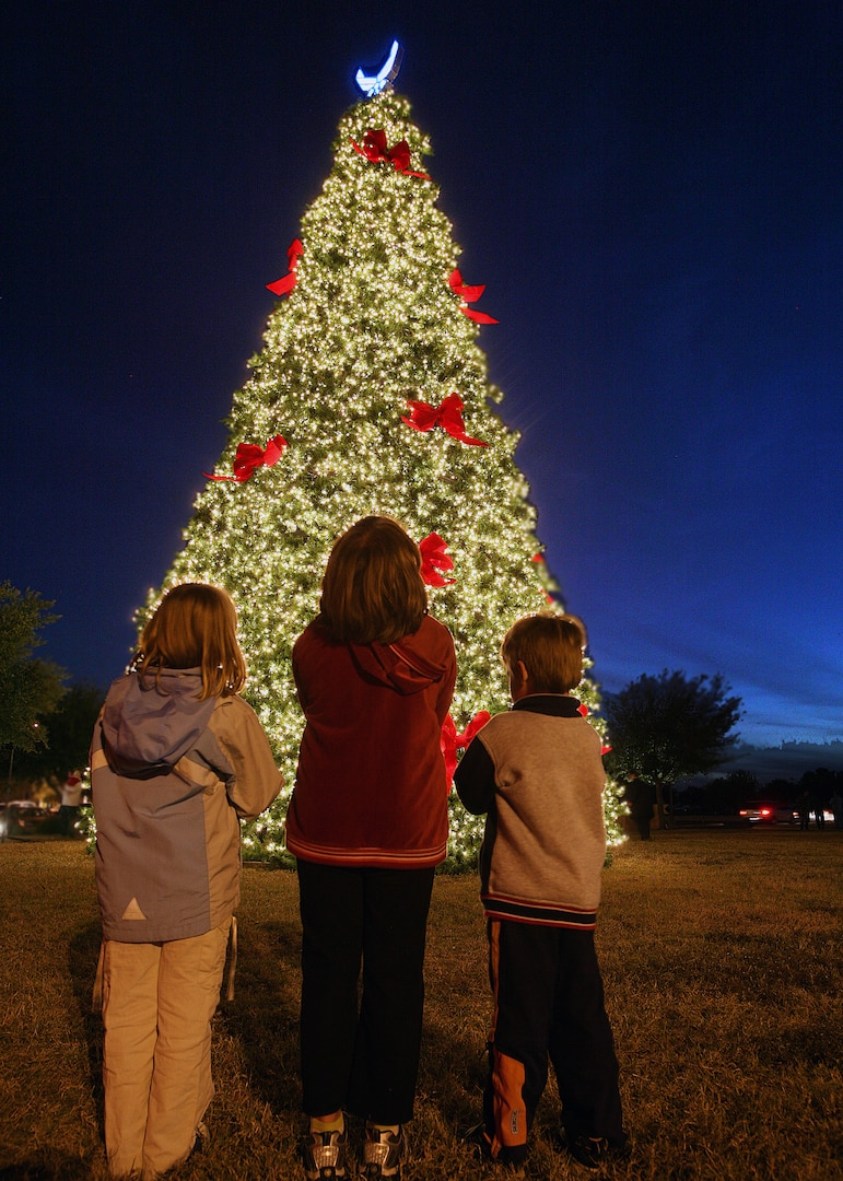 Erin, left, Nancy and John McClain admire the base Christmas tree at the Gateway Club Nov. 29. The children are the daughters and son of Stephanie and Chaplain (Capt.) L. Bryan McClain of the 37th Training Wing at Lackland Air Force Base, Texas. (USAF photo by Robbin Cresswell)