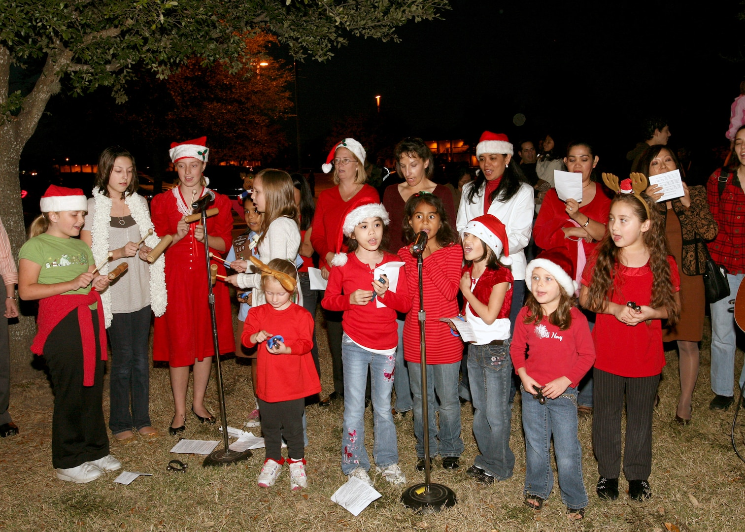 Members of the Chapel Children's Choir at Lackland Air Force Base, Texas, provide musical entertainment at the annual Christmas Tree Lighting on Nov. 29. (USAF photo by Robbin Cresswell)