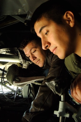 MCCONNELL AIR FORCE BASE, Kan. -- Senior Airman Rob Poe, 349th Air Refueling Squadron, trains Senior Airman Jeremiah Ibarra, 349th Air Refueling Squadron, on the in-flight refueling system on Nov. 26. In-flight refueling system operators make a difference by safely and completely checking the aircraft before any mission. (Photo by Airman 1st Class Roy Lynch III)