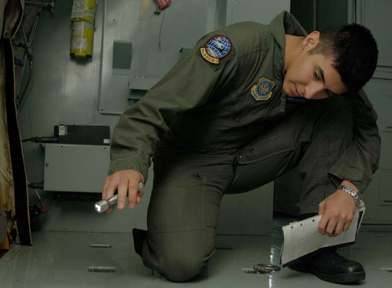 MCCONNELL AIR FORCE BASE, Kan. -- Senior Airman Jeremiah Ibarra, 349th Air Refueling Squadron, checks the plane for any damage on Nov. 26. In-flight refueling system operators make a difference by safely and completely checking the aircraft before any mission. (Photo by Airman 1st Class Roy Lynch III)