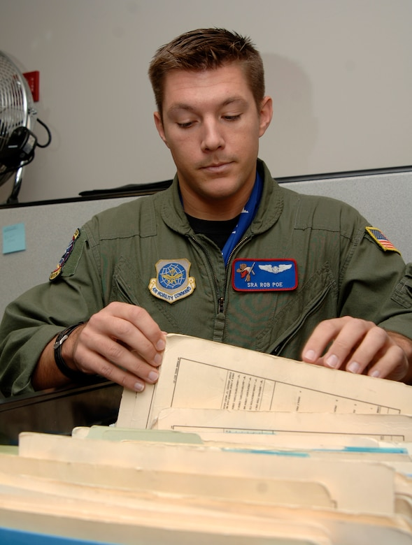 MCCONNELL AIR FORCE BASE, Kan. -- Senior Airman Rob Poe, 349th Air Refueling Squadron, pulls training records for the days training session on Nov. 26. In-flight refueling system operators make a difference by safely and completely checking the aircraft before any mission. (Photo by Airman 1st Class Roy Lynch III)