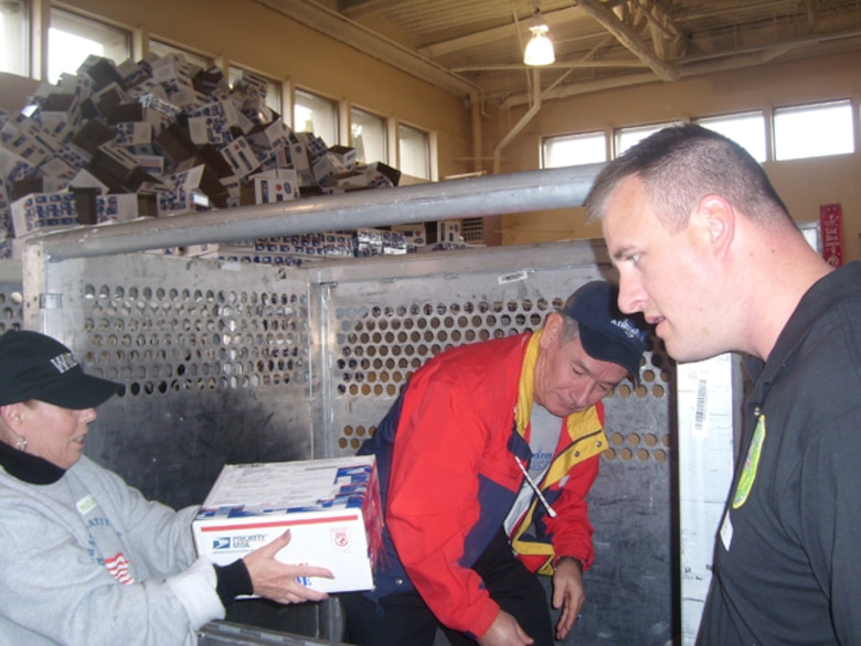 Volunteers from  Los Angeles AFB participated in Operation Gratitude, a civilian-based drive to send care pages to troops deployed overseas.  Local volunteers packed 8,000 care packages, Dec. 1. Operation Gratitude will be sending its 300,000th care package during the month of December.  Base participation was spearheaded by the GPS Wing Company Grade Officer Council.
