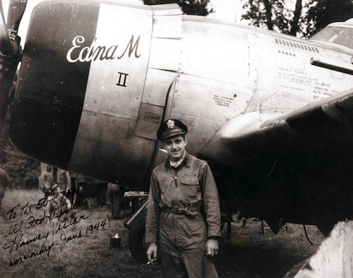 The 50th Tactical Fighter Wing provided air support for Allied forces during the D-Day landings at Normandy, France. Harvey Victor, a pilot with the 50th TFW, poses with his P-47 Thunderbolt shortly after D-Day in this photo. (U.S. Air Force File Photo)