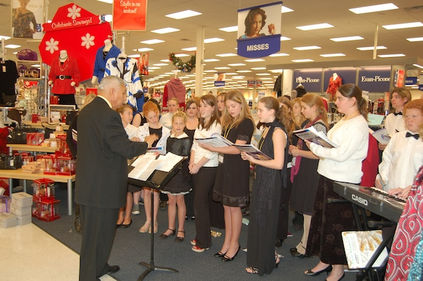 The Hanover School District 28 choir performed at the Base Exchange Dec. 5. Music director Fernando Ornelas led the students in classic holiday songs for the many holiday shoppers at the store. (U.S. Air Force photo by Corey Dahl)