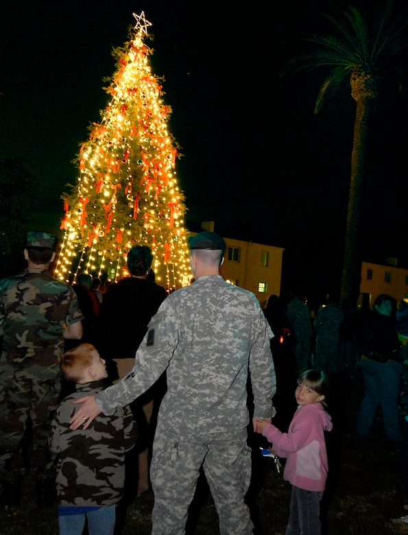 The holiday season was kicked off with the lighting of the base's Christmas tree on Fort MacArthur, Nov. 29.  The event featured a visit from Santa Claus. (Photo by Joe Juarez)