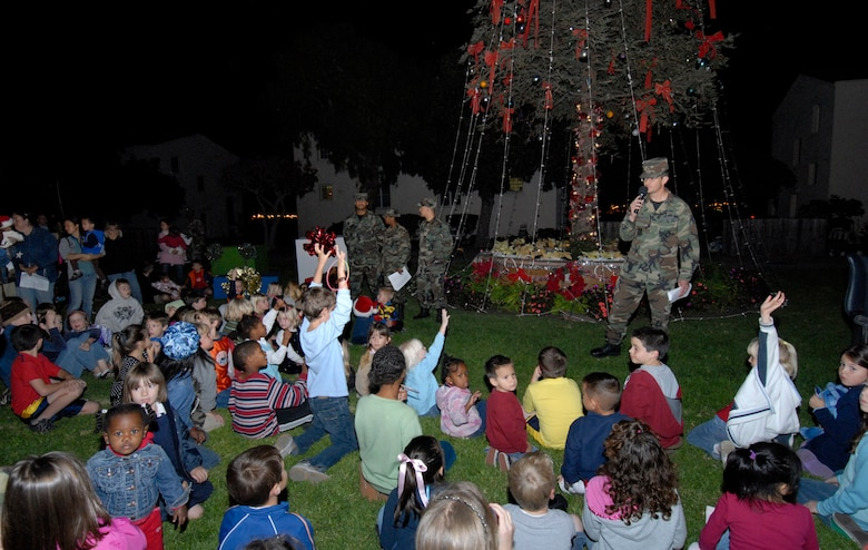 Colonel Joseph Schwarz, 61st Air Base Wing commander, talks to base children at the annual tree lighting  held on Fort MacArthur, Nov. 29. The children were waiting for a visit from Old St. Nick. (Photo by Joe Juarez)